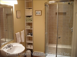 3 Piece Bath with Angled Glass Shower Doors, Tiled Seat, Pedestal Sink