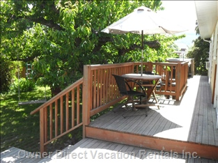 Deck Leads to Fenced Back Garden