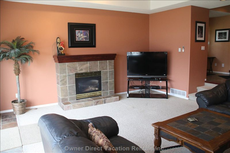 Downstairs Living Room with Gas Fireplace and 55 Inch Sony Tv