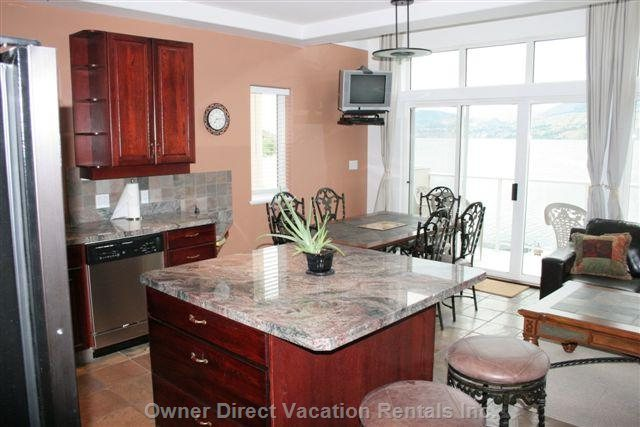 Kitchen Island and Indoor Eating Area with Unobstructed Views of the Lake.