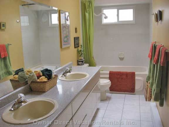 Main Bathroom, Upper Floor - another Skylight Brightens this Large Bathroom.  the Owner Provides Special Beach Towels for all of You.  they Are Stored in a Cupboard Here.   a Dispenser on the Tub Wall has Shampoo, Conditioner, Shower Gel and Liquid Body Soap for You.