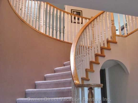 Entrance from Main Floor up to Second Floor - Coming through the Main Floor Etched Glass Front Doors Guests Are Greeted by a Lovely Bright & Skylight Lit Winding Staircase Leading to the Upper Main Floor.