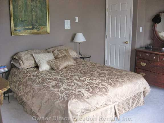 Upper Floor Master Bedroom - this Queen Bedroom has its Own Ensuite with Jacuzzi Tub.  There is a Private Deck with a Bistro Set for you to Sit with a Cool one, Relax and Enjoy the Morning Or Evening Lake and Mountain Views.