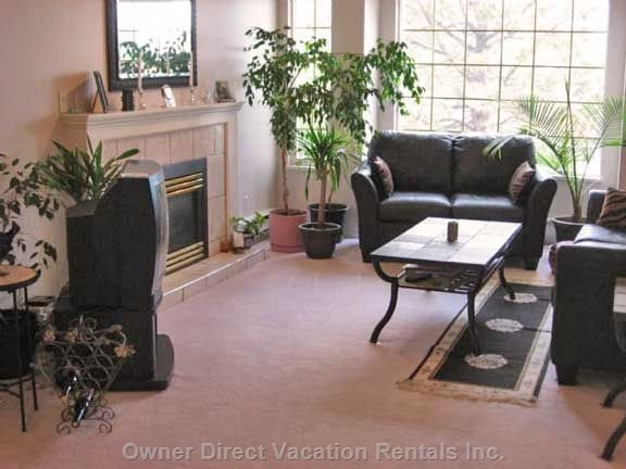 Upper Living Room - the Large Living Room Windows Look Westward to the Lake and Mountains for Fabulous Sunset Views.