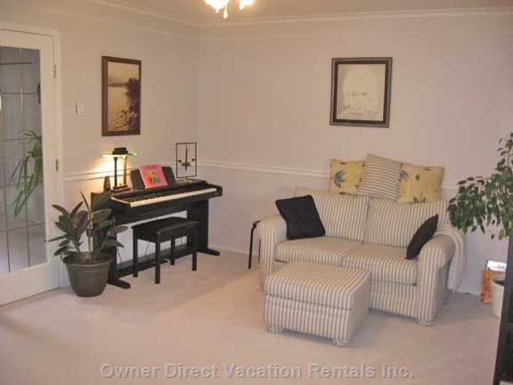 Upper Music Room - Electric Piano, Trumpet, Glockenspiel, Guitars, Penny Flutes, African Shakers, and a Variety of Cd'S Are Here for your Enjoyment.  this is Also a Lovely Room to Close the French Doors and Put your Feet up with a Good Book Or Have a Quiet Conversation.
