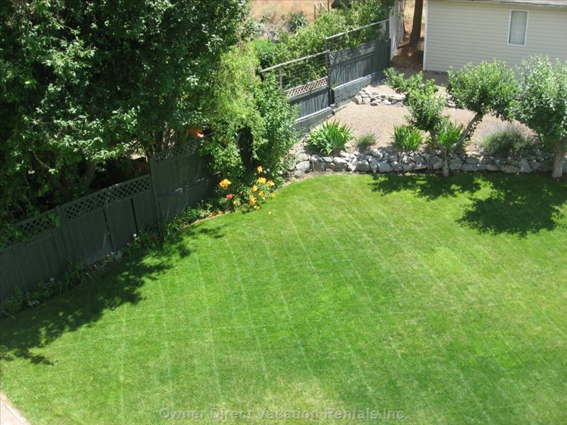 Backyard View from Top Deck - this Yard is Large Enough for Lots of Fun.  Bocce Ball, Croquet, Volleyball Game Sets Are all Available.  Owner Also has Blow up Floaties, and Pumps-  for those who May Want to Take a Leisurely Float down the Penticton River Channel!