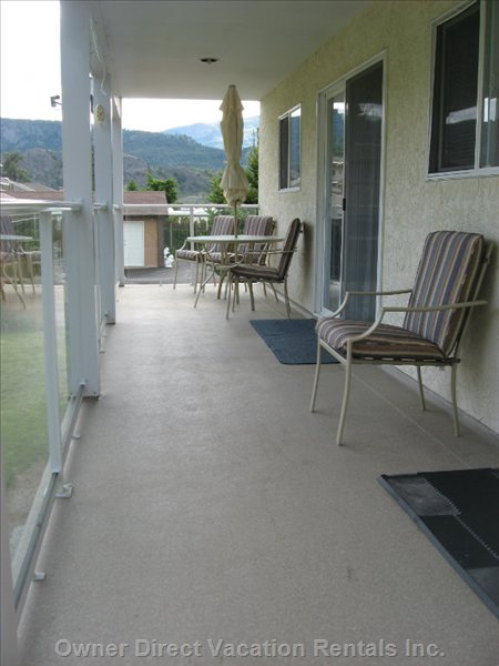 Main Floor Back Deck - this Deck Serves the Main Flloor of the Home.  There is a Patio Table Set Here for Meals to be Taken outside, Enjoying the Fresh Air and Mountain Views.  the Deck has a Stairway down to the Backyard to Access Play Area/ Secret Garden/ Patio and Bbq.