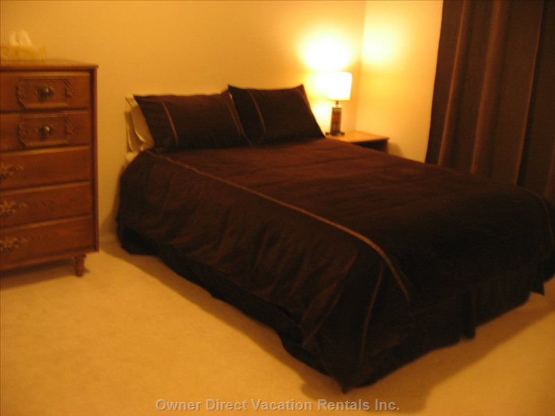 Main Floor BD # 5 - this is a Large Bedroom with a Comfy Queen Bed, and a Large Chest of Drawers.  There is Plenty of Room in the Closet.