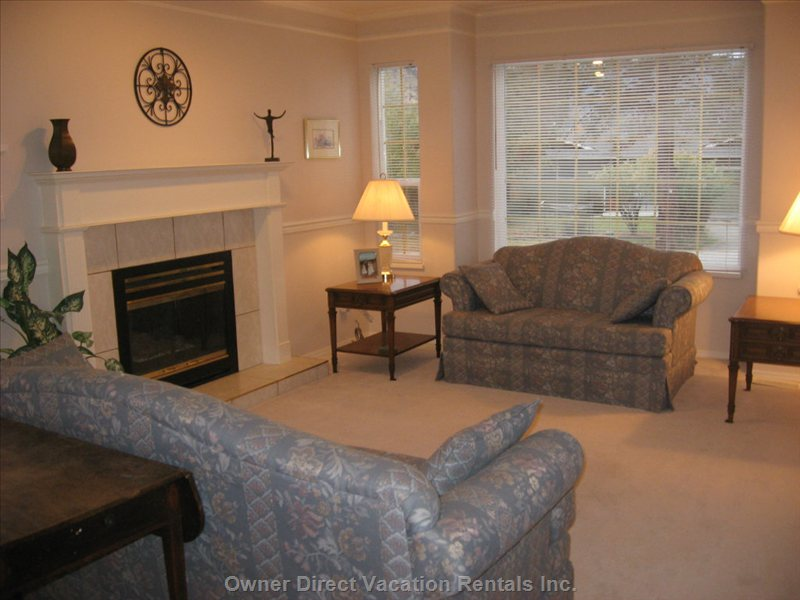 Main Floor Living Room - this Main Floor Living Room is a more Quiet Sitting Or Reading Space, Away from the Kitchen, Den and Deck Areas.  it is Situated Facing the Front of the Home.