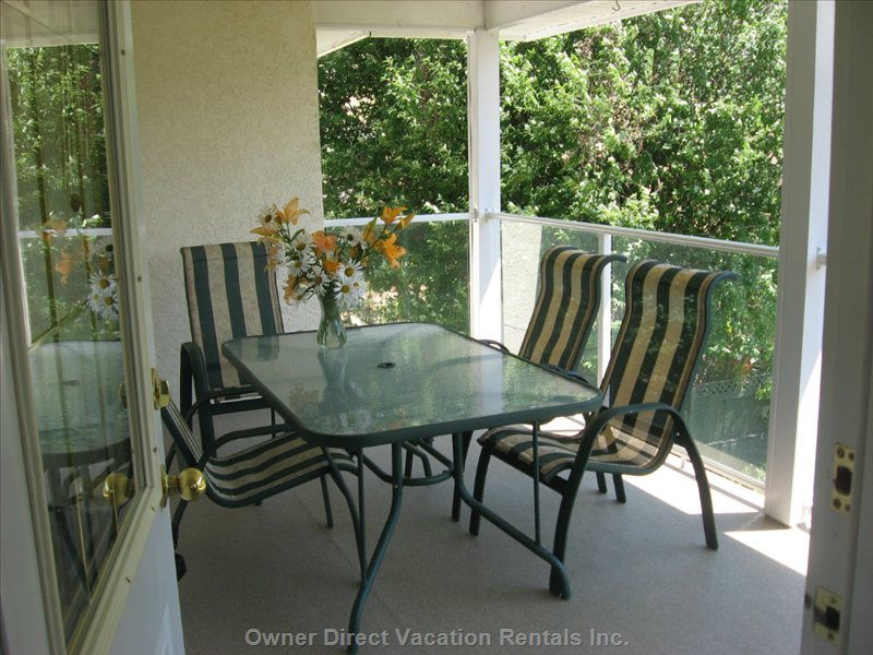 Top Floor- Back Deck - a Large Table for your Outdoor Meals, Taking in the Amazing Okanagan Valley Views.