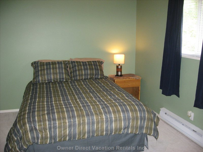 Top Floor BD # 3 - another Queen Awaits in a Large Bedroom with Lots of Closet Space, and a Good Sized Dresser.
