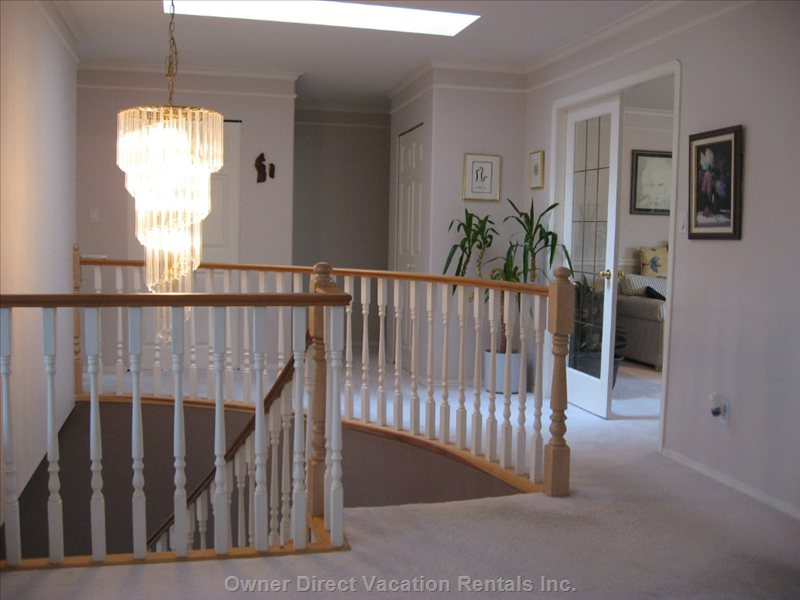 Top Floor Hall - the Large Overhead Skylight Opens this Hall to a Music Room in the Background, through French Glass Doors.