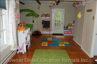 Large Play Area for the Kids with Extra TV, Toddler Bed and Playpen.