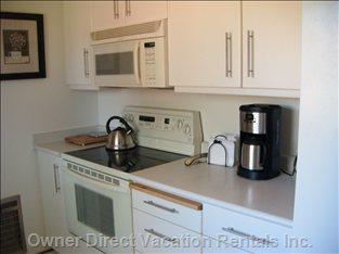 You Will be Pleased to Have a Full Size Stove, Microwave and Refrigerator with an Ice Maker.