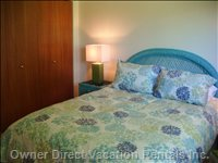 The Master Bedroom has a Very Comfy Queen Bed Decked out with a Duvet and Quality Bedding.