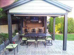 "Covered Table & Chairs / Bar with 42"" Flat Screen. Get out of the Sun/Rain Or Just Enjoy an Evening Meal Outside in the Gazebo"