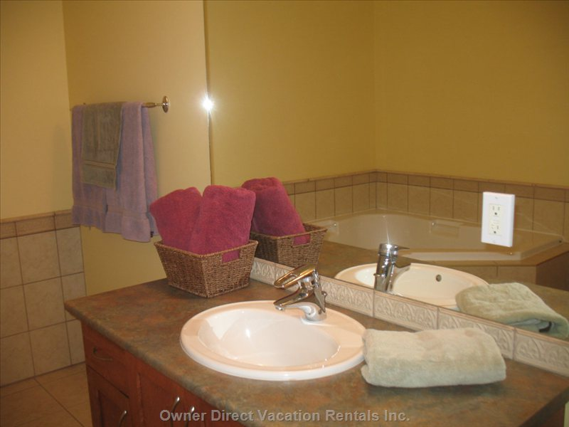 Master Bathroom - Large Corner Soaker Bathtub, Glassdoor Shower, Large Vanity, Comfort Seat W/C
