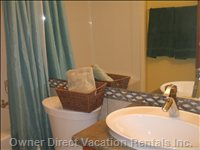 Guest Bathroom - Shower Tub, Single Sink Vanity, Comfort Seat W/C