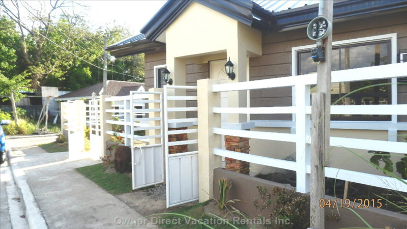 House with Perimeter Fence & Gate