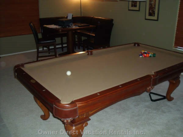 Pool Table with Computer/Card Table in Background