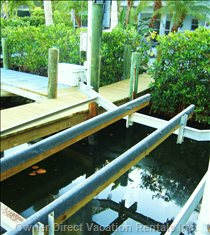 Private Boat Dock & Auto Boat Lift has both Power and Water for your Convenience.