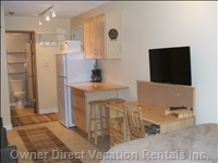 Efficient Kitchenette with Seating for Two and Desk/Entertainment Area