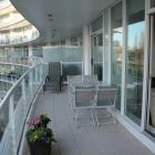 Enjoy our 30' Baclony with Views of the Inner Harbour and Olympic Mtns Or a Lovely Sunset on our Patio Furniture