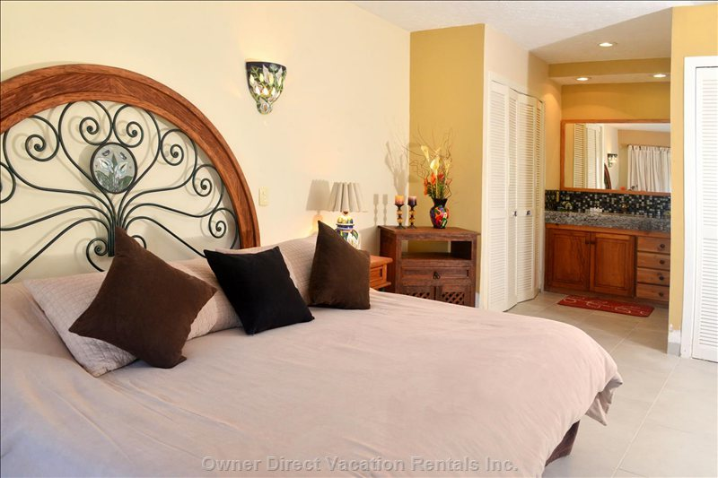 Master Bedroom with En Suite Bathroom. The Bedroom has a King Bed and Beautiful Ocean Views