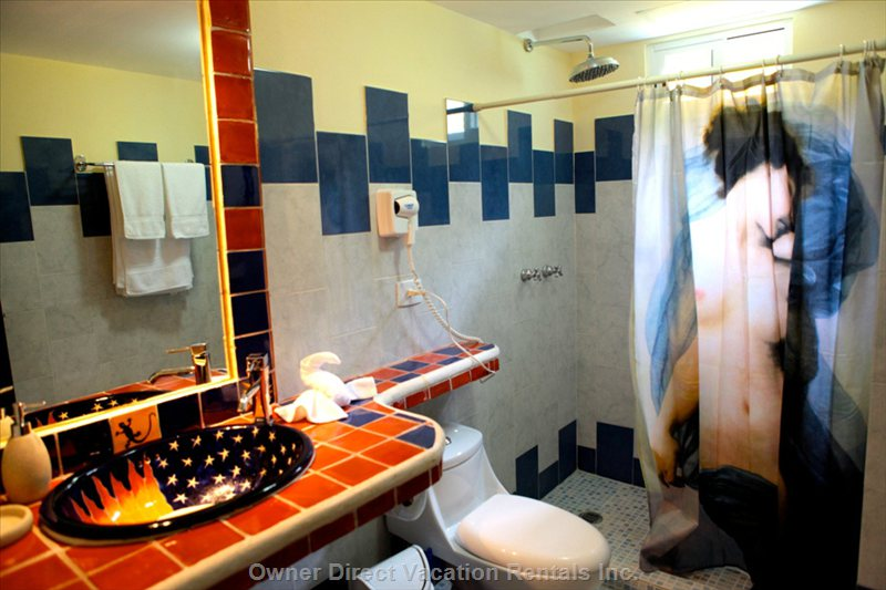 Bathrooms Have a Touch of Mexican Style with Talavera Tiles.
