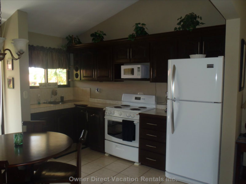 Modern, Fully Stocked Kitchen.  Brand New Full Sized Refrigerator & Granite Countertops