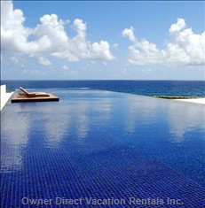 Sapphire Blue Pool Attracting the Rays of the Caribbean Sun. The Villa's Magnificent Centrepiece.