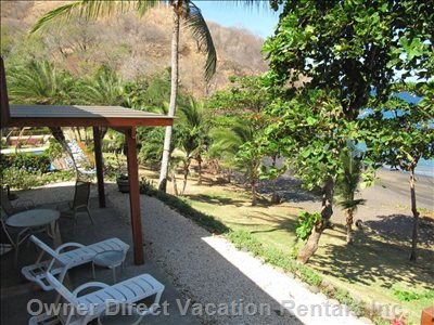The Patio of Villa - a Roomy and Private Patio Overlooking the Beach. Take the Short Steps down to the Pool and Beach.