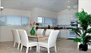 Travertine Dining Table and Granite Counters in Kitchen