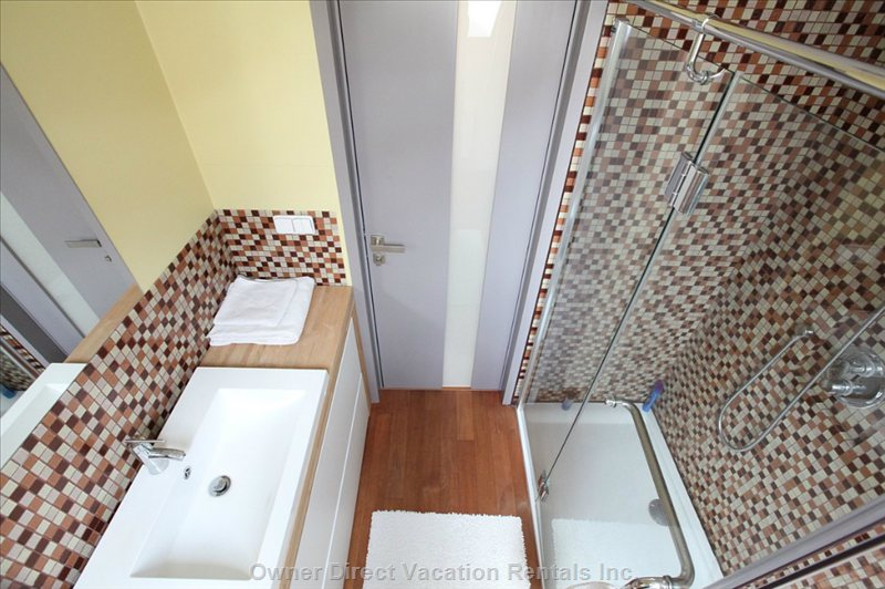 In the Second Bathroom is Spacious Shower, Wc, Bidet, Washer and Dryer.