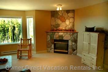 Shows Large, Bright Bay Window, and Rock Fireplace