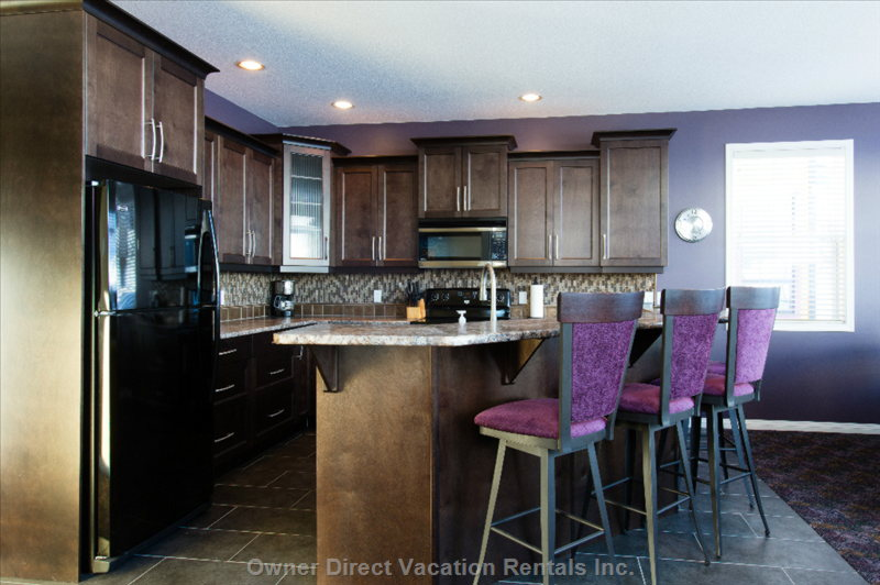 The Kitchen and Raised Bar Provide Seating for 4 People.