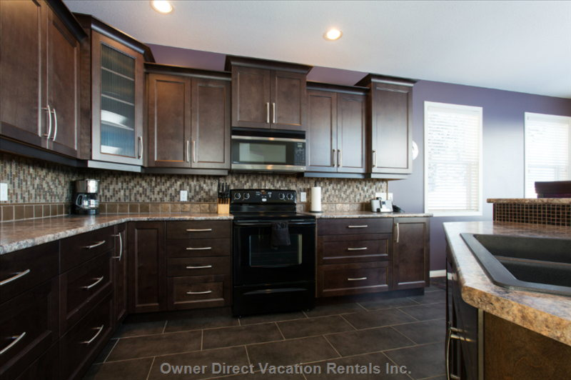 The Newly Remodeled Kitchen has Heated Tile Floors and Views of the Alpine Meadows Chairlift and Christmas Bowl.