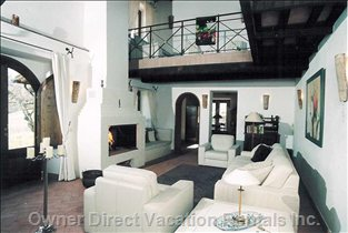 Living Room with Fireplace and Doors to the Terrace