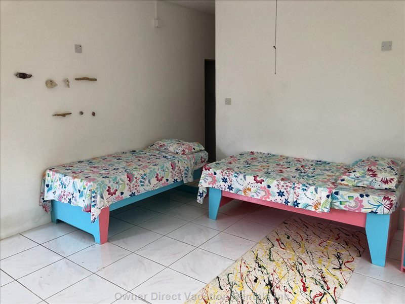 Two New Children Beds for Second Bedroom. Playful Tropical Colours Will be Especially Inviting for Young Kids.