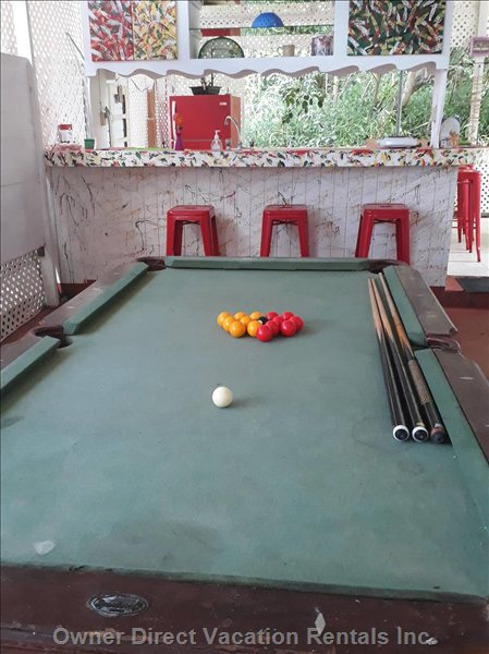 Chill with your Friends Playing Pool in Breezy Outdoor Space Next to Kitchen Area.