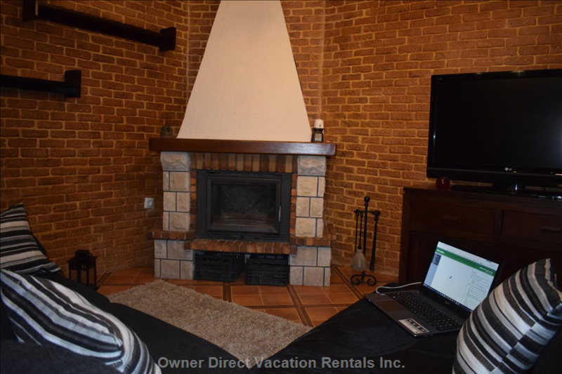 A14. Living Room with Fireplace and Tv.