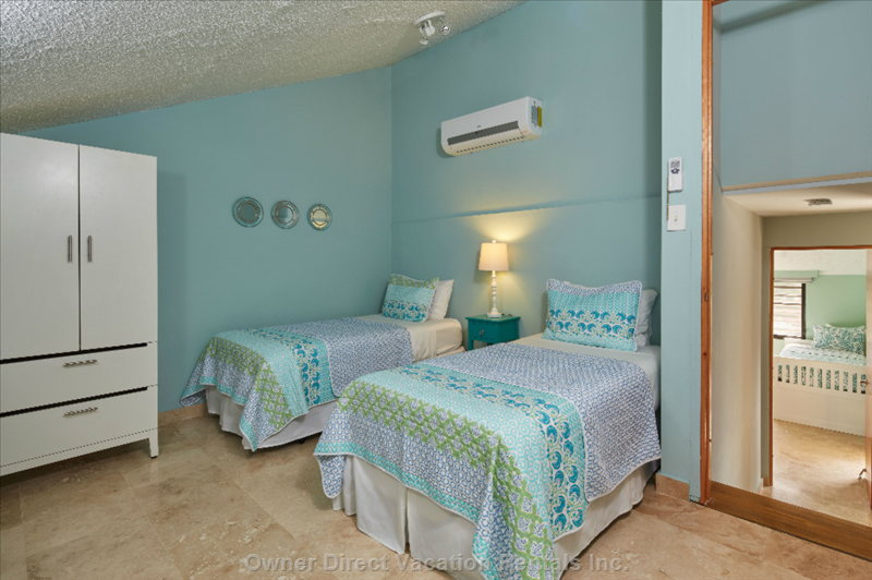 Upper Bedroom with Two Twins and Two Roll Away Beds for a Total of 4 People