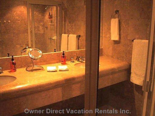 Gleaming Marble Bathroom with 2 Sinks & Large Shower Area