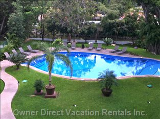 View of the Heated, Salt Water Pool, Lounge Chairs and Grounds Area from our Deck.
