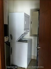 Laundry Room with Stacking Washer & Dryer.