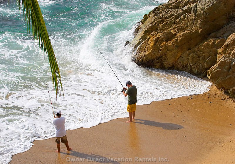 Fishing from our Secluded Beach. Photo from the Green Bedroom Balcony