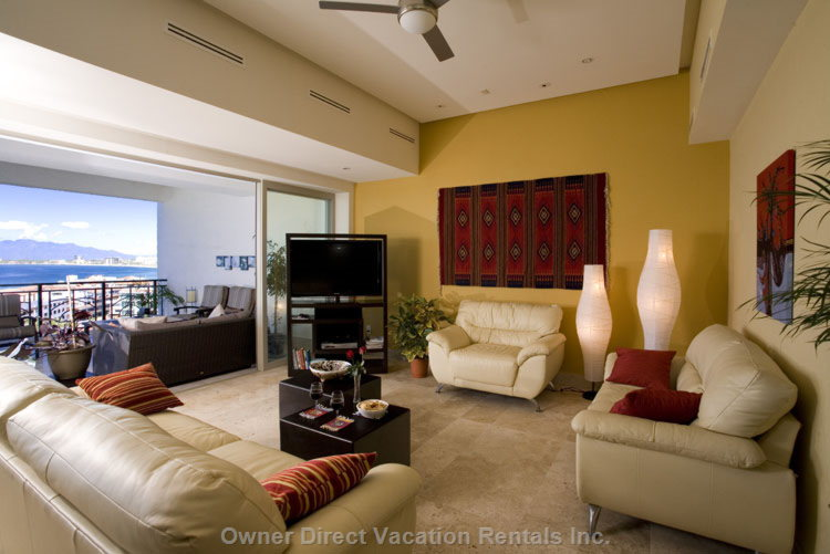 Friendly Comfortable Living Room, Large Hd TV.  - Lots of Seating on Luxurious Leather Couches, but you Will Mostly be on the Balconies Or at the Pool, we Bet!