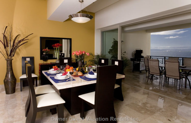 Dining Room Adjoining Balcony with Ocean View - Spacious Dining Room Located between Kitchen and Dining Porch. Great Views and Breezes. Buffet Stocked with Margarita, Martini, Wine and other Glasses, plus Fabric Napkins and Placemats.