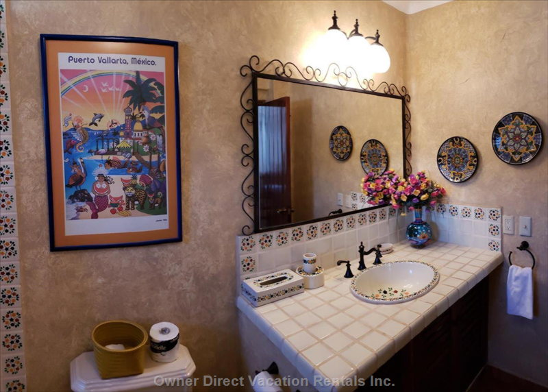 Beautiful Rustic Mexican Tile Work and Artwork in both Bathrooms