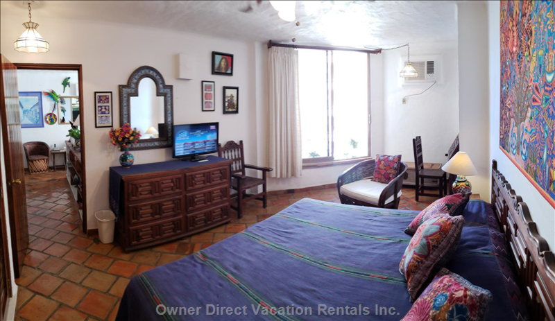 Very Spacious Bedrooms. Both with Seating Areas.  Air Conditioning and Fans. Very well Lit